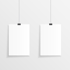 Realistic hanging papers with clips and shadow. Vector illustration of two hanging note or page with a clip, string and plenty of copy space.