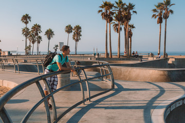 Venice beach skate park during early morning sunrise lights.