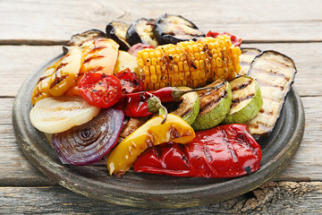 Grilled vegetable on brown cutting board