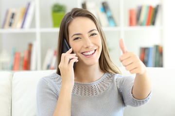 Satisfied customer talking on phone and looking at you