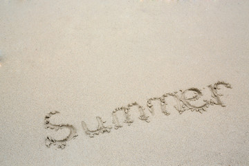 The word Summer in the sand of a beach.