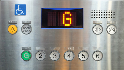 Elevator internal buttons control panel, Braille numbers and lift symbols.