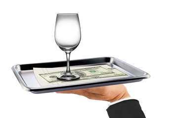 Wine glass / Empty wine glass and dollar bills on stainless tray on hand waiter on white background.