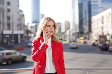 Young businesswoman talking on mobile phone outdoors