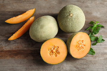 Fresh ripe melons on wooden background