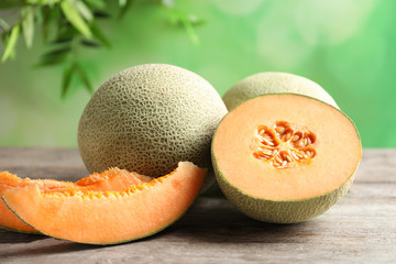 Fresh ripe melons on wooden table outdoors
