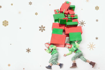 Funny two boys dressed in Elf costumes for Christmas