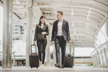Business man and woman are going on business trip. Fototapete