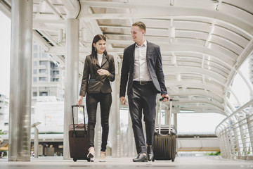 Business man and woman are going on business trip.