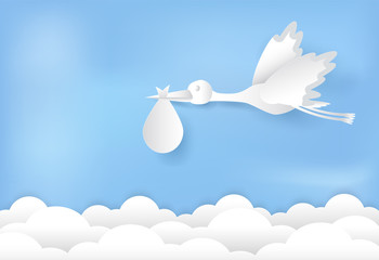 Paper art of stork flying with baby on blue sky