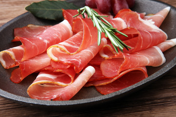 prosciutto with rosemary  or ham of black forest or serrano.