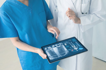 Medical technology concept. Doctor and nurse watching electronic medical record.