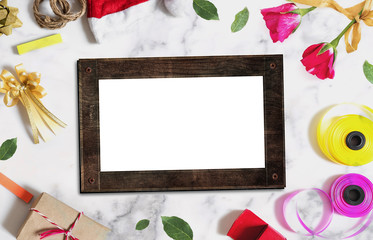 Christmas decorations background. Blank wooden picture frame with Christmas and Valentines ornaments on white wood