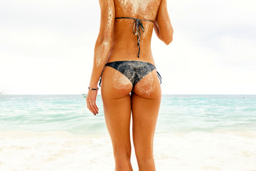 Woman buttocks slim figure on beach of paradise island Zanzibar