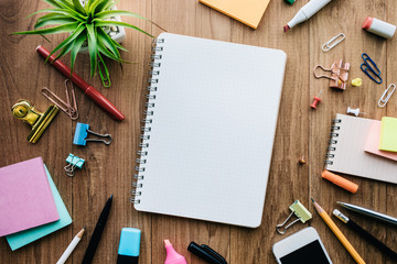 Top view of blank notepad and office supplies on wood background.business creativity and inspiration concepts Wall mural