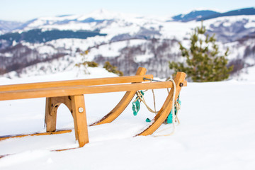 Wooden sleds on snow covered mountain