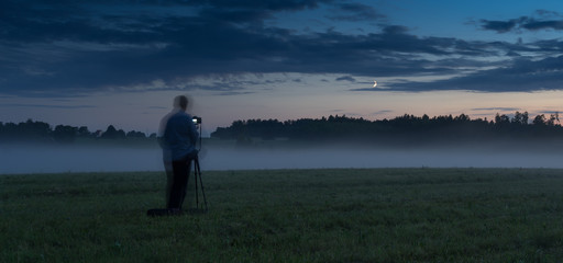 Photographer in a fog field
