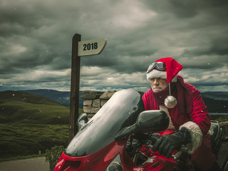 Trip of Santa Claus in Scotland on a hevy motorcycle.