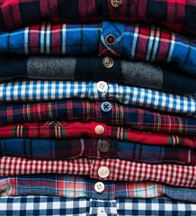 stacks of checkered shirts