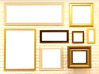 empty picture frames on brick wall