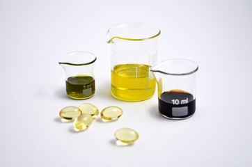 Glassware stock images. Measuring cup and pills stock images. Glass Measuring Beaker. Laboratory beaker on a white background. Beaker with pills. Glassware with chemical liquid