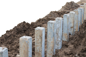 Concrete pile with barrier to the ground.