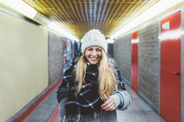 young beautiful woman looking camera laughing posing underground