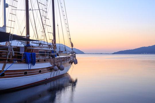 Single boat on Marmaris seaport during sunrise