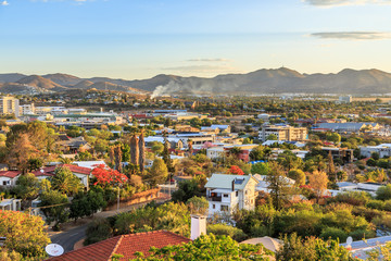 Windhoek rich resedential area quarters on the hills with mountains in the background, Windhoek, Namibia Wall mural