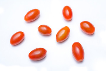 Macro Of A Collection Of Five Red Datterino Plum Tomatoes