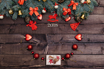 Sigh symbol from number 2018 on vintage style wooden texture background. Happy New Year 2018 greetings on wooden. Empty space for your text. Christmas background with decorations, xmas tree and gift