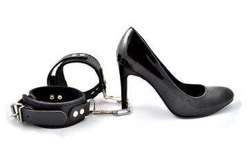 High heels and cuffs stock images. Black high heels on a white background. Black leather cuffs