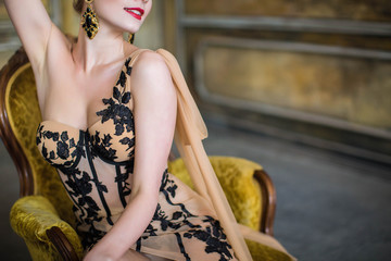 beautiful female body in brown dress close-up. Creative portrait of fashion