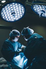 Surgeons doing a foot surgery