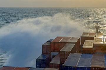 Container ship in stormy sea.