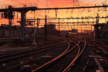 A train on the railroad tracks  during sunrise. Gare de Lyon-Perrache, Lyon, France.