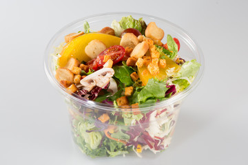 Fresh salad cup container on white background