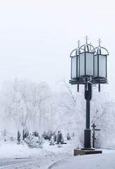 Street lamp in the winter snowy street