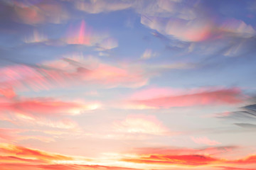 Overlay several photos on each other in a time lapse. Colorful watercolor clouds in the sky