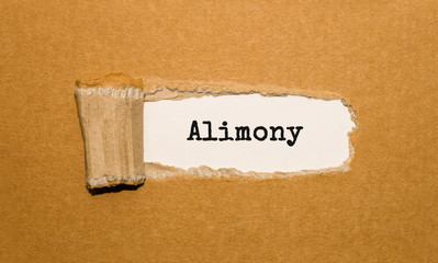 The text Alimony appearing behind torn brown paper