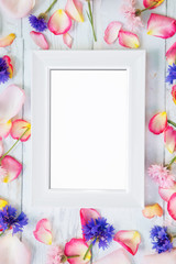 White frame with petals around frame