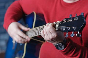 hand playing folk guitar action design