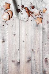 Wooden background with traditional ginger cookies and spices