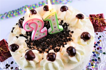 An Image of a birthday cake with candle - 21