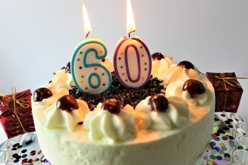 An image of a birthday cake with candle - 60