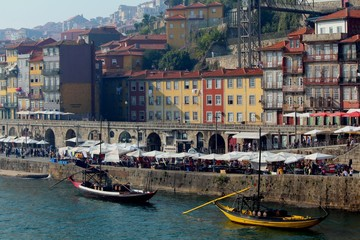 Ribeira and its beautiful houses and boats. The photo was taken while crossing the bottom deck of the Dom Luís I Bridge from Gaia to Porto.