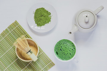 Matcha green tea on  on white wooden background