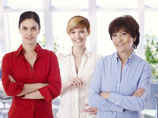 Group portrait of confident female office workers