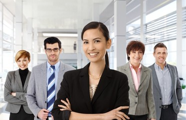 Asian businesswoman and business team