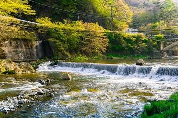 stream in mountain near village